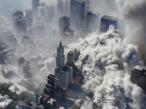 This photo taken Sept. 11, 2001 by the New York City Police Department shows smoke and ash engulfing the area around the World Trade Center in New York. (AP Photo/NYPD, Det. Greg Semendinger)