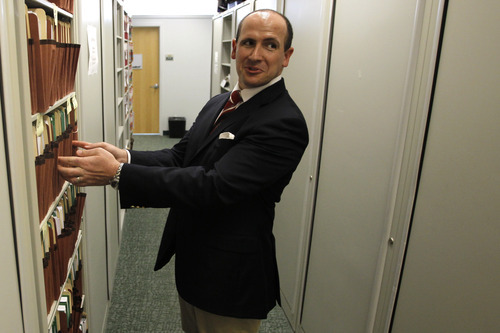 PETER LOCKLEY  |  Special to the Tribune Daniel Fabricant, director of Dietary Supplement Programs at the Food and Drug Administration takes a look at a large group of folders comprising a single new dietary ingredient (NDI) study during a tour of his office in College Park, Md.