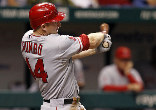 Los Angeles Angels' Mark Trumbo follows through on his two-run home run during the fourth inning of a baseball game against the Tampa Bay Rays, Friday, April 29, 2011, in St. Petersburg, Fla. (AP Photo/Mike Carlson)