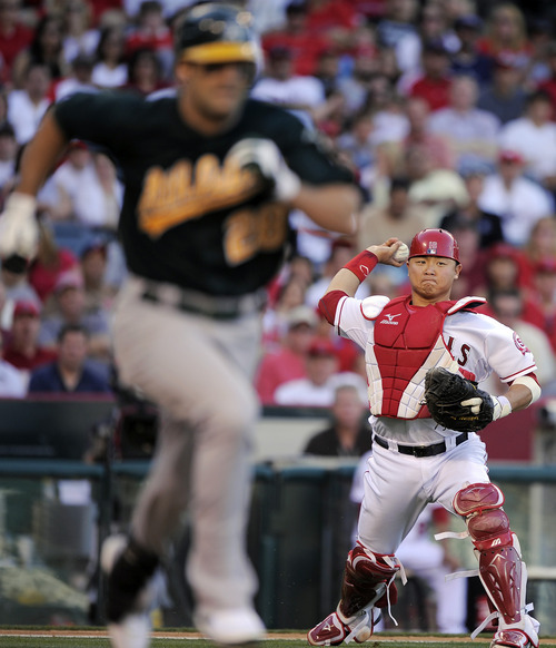 Los Angeles Angels catcher Hank Conger throws out Oakland Athletics' Conor Jackson during the eighth inning of a baseball game, Wednesday, April 27, 2011, in Anaheim, Calif.  (AP Photo/Mark J. Terrill)