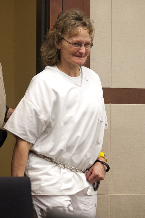 Erin Hooley  |  The Associated Press Debra Brown, 53, smiles as she enters the courtroom for a hearing in Judge Michael DiReda's 2nd District Court in Ogden in January. She was convicted in the shooting death of her employer, Lael Brown, no relation, in 1995.