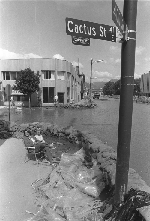 Al Hartmann  |  The Salt Lake Tribune Unidentified women try fishing in temporary river along 400 South just off State Street in downtown Salt Lake City in late May 1983.