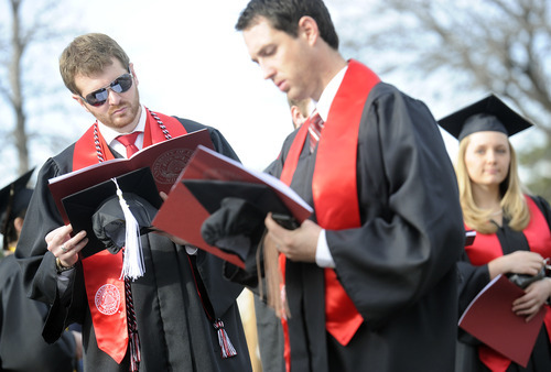 Sarah A. Miller  |  The Salt Lake Tribune  Graduates look over the commencement program as they wait in line outside of the Huntsman Center before the procession Friday, May 6, 2011, at University of Utah in Salt Lake City. More than 7,000 students received their degrees.