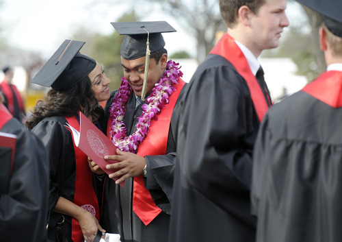 Sarah A. Miller  |  The Salt Lake Tribune  Ulises Lagunas, of Park City, and his girlfriend Lupe Ochoa, of Salt Lake City, talk while waiting in line outside of the Huntsman Center on Friday, May 6, 2011, for the University of Utah commencement ceremony in Salt Lake City. More than 7,000 students received their degrees.