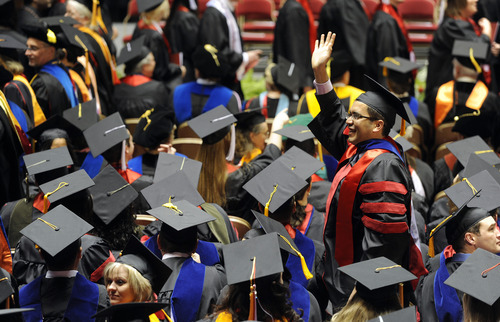 Sarah A. Miller  |  The Salt Lake Tribune  A graduate waves to the crowd during the University of Utah commencement at the Huntsman Center on Friday, May 6, 2011, in Salt Lake City. Over 7,000 students received their degrees.