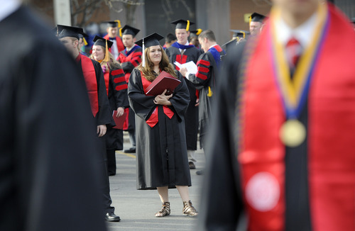 Sarah A. Miller  |  The Salt Lake Tribune  English student Natalie Paulsen, of Sandy, waits in line outside of the Huntsman Center before the procession Friday, May 6, 2011, at University of Utah in Salt Lake City. Over 7,000 students received their degrees.