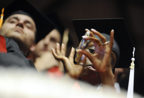 Sarah A. Miller  |  The Salt Lake Tribune  A University of Utah graduate uses her phone to capture video of the commencement ceremony at the Huntsman Center on Friday, May 6, 2011, in Salt Lake City. Over 7,000 students received their degrees.