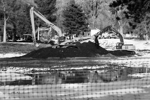 Al Hartmann  |  The Salt Lake Tribune Backhoes scooped soil out of Liberty Park Pond as part of the cleanup from the Chevron Pipeline Red Butte Creek spill last summer.