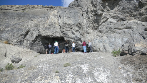 Tom Wharton | The Salt Lake Tribune Visitors peer into the outside of Danger Cave near Wendover.