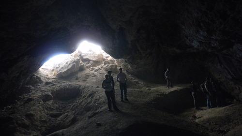 Tom Wharton | The Salt Lake Tribune Three people explore the inside of Juke Box Cave near Wendover.