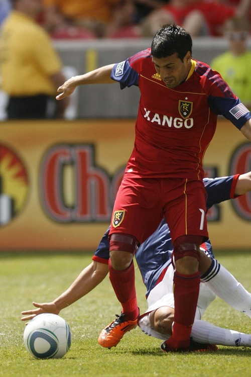 Trent Nelson     The Salt Lake Tribune Real Salt Lake's Javier Morales falls with a horrific injury, with Chivas USA's Marcos Mondaini defending on May 7.
