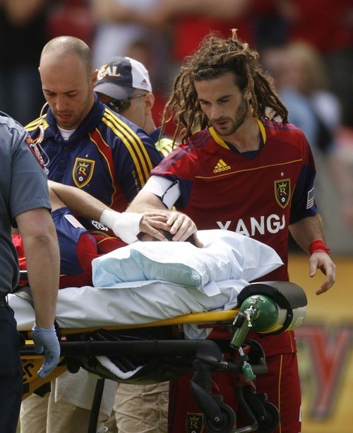 Trent Nelson     The Salt Lake Tribune Real Salt Lake's Kyle Beckerman offers a hand of support to injured teammate Javier Morales on May 7.