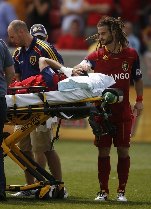 Trent Nelson     The Salt Lake Tribune Real Salt Lake's Kyle Beckerman offers a hand of support to injured teammate Javier Morales on Saturday.