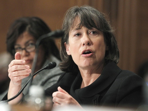 Associated Press file photo FDIC Chairwoman Sheila Bair said some of the revenue decline in the banking industry was due to new rules that limit banks' charges for overdrafts on checking accounts. Banks are now barred, for example, from automatically enrolling customers in checking overdraft programs, which often charge $35 or more per violation.