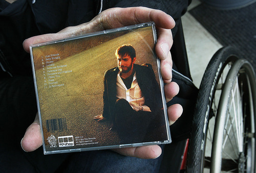 Scott Sommerdorf  |  The Salt Lake Tribune Joel Brown, a University of Utah student who has had his new album produced by Spy Hop Records, holds the cd case showing the back of his new album. Joel has been paralyzed since he was 9.
