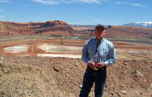 JUDY FAHYS     The Salt Lake Tribune Atlas tailings project manager Don Metzler, with the Department of Energy, stands in front of the site near Moab where millions of tons of uranium waste have been removed. A new contract went to an Idaho company to take over from EnergySolutions Inc. And Rep. Jim Matheson said he is concerned that a scale-back in funding will slow down the project.