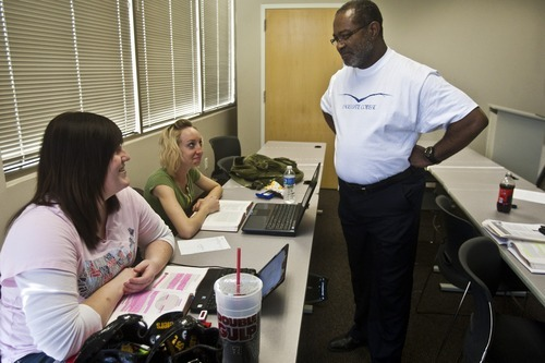 Chris Detrick | The Salt Lake Tribune  Ron Stallworth teaches Amanda Clark and Brandee Wright in a criminal justice class at Eagle Gate College on Tuesday, April 19, 2011.  Twenty years after Stallworth first started training cops to better recognize the warning signs of gangs --along with helping to implement anti-gang strategies in communities around the state --Stallworth is bringing his expertise to Davis County. Davis County Attorney Troy Rawlings recruited Stallworth to become the county's new gang intelligence consultant.