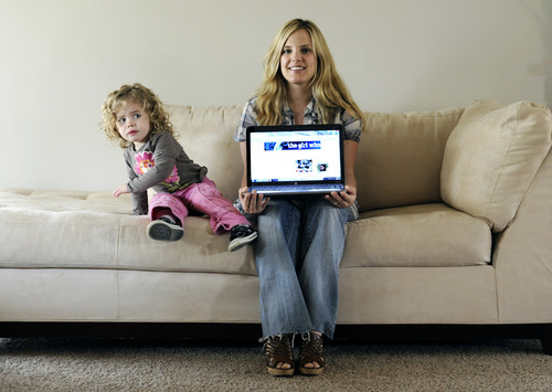 Sarah A. Miller  |  The Salt Lake Tribune  Monica Bielanko poses with the laptop she uses to update her blog, The Girl Who, at her home in Holladay on Tuesday, May 3, 2011. Bielanko has been running the blog The Girl Who since 2005. Also pictured is her daughter Violet, 2.