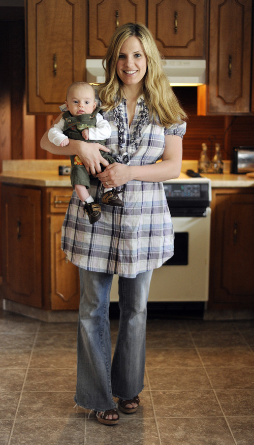 Sarah A. Miller  |  The Salt Lake Tribune  Monica Bielanko poses with her son Henry, 2 months, in her home in Holladay on Tuesday, May 3, 2011. Bielanko has been running the blog The Girl Who since 2005.