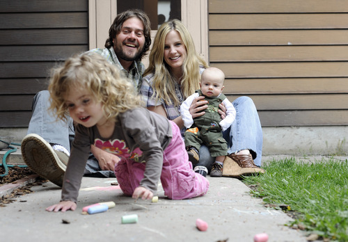 Sarah A. Miller  |  The Salt Lake Tribune  Monica Bielanko poses with her husband Serge and their two children Henry, 2 months, and Violet, 2, at their home in Holladay on Tuesday, May 3, 2011. Bielanko has been running the blog The Girl Who since 2005 and writes about anything from living in Brooklyn, N.Y., to breastfeeding at Wal-Mart.