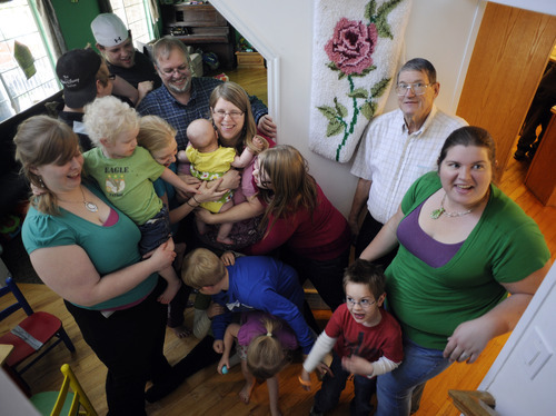 Sarah A. Miller  |  The Salt Lake Tribune  Sandy Christensen is surrounded by her large family at her home in South Jordan Wednesday May 3, 2011. Christensen has 12 children ranging from 6 months to age 26 and is author of the blog Twelve Makes a Dozen. She is also a grandmother.