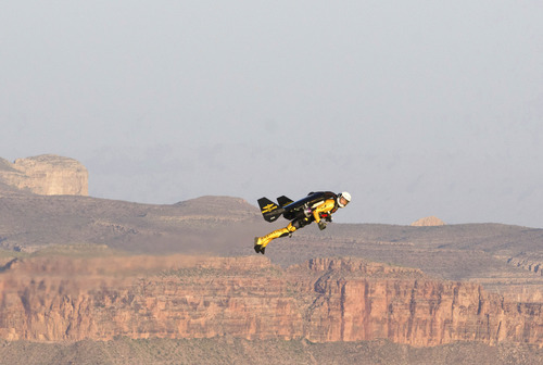 Breitling  |  The Associated Press Swiss adventurer Yves Rossy flys over the Grand Canyon in Arizona on Saturday in his custom-built jet suit.