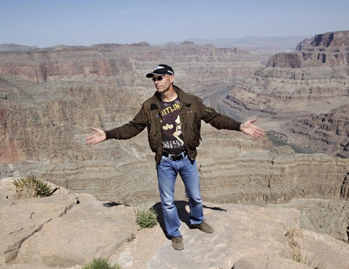 Swiss adventurer Yves Rossy stands on the ledge of the Grand Canyon on Guano Point on the Hualapai Indian Reservation Friday, May 6, 2011. Rossy cancelled first U.S. flight in a custom built jet suit due to safety concerns.  The Federal Aviation Administration earlier Friday had approved plans for the 51-year-old adventurer to use the Grand Canyon as a backdrop for his first U.S. flight in a jet-propelled wing suit.  Rossy calls himself the JetMan.  (AP Photo/Matt York)