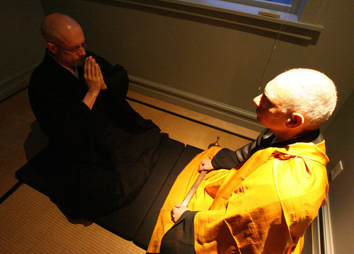 In this 2005 Tribune file photo, Genpo Roshi Dennis Merzel, right, interviews Michael Zimmerman to test his conceptual mind and transcendental understanding to help him go beyond the dualistic mind.