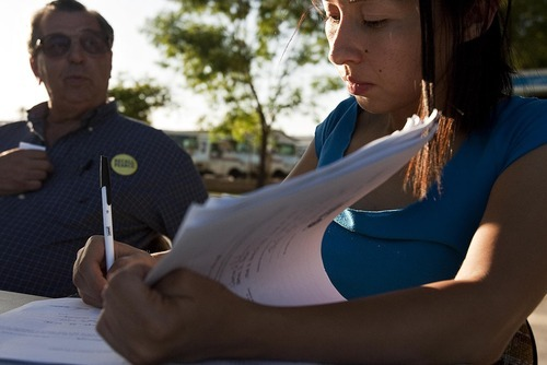 DJAMILA GROSSMAN  |  The Salt Lake Tribune Bob Unferth of Phoenix watches notary public Lilia Alvarez certify signatures gathered to recall Arizona Senate President Russell Pearce, R-Mesa. Pearce, the leader of the anti-illegal immigration movement in the state, says opponents underestimate his popularity with the majority of voters.