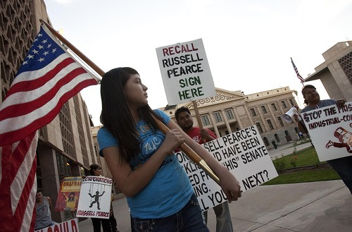 DJAMILA GROSSMAN  |  The Salt Lake Tribune Twelve-year-old Alma Olague participates in a demonstration in front of the state Capitol protesting Arizona's tough immigration enforcement law and calling for the ouster of Senate President Russell Pearce. Pearce is the main sponsor and advocate of the law.