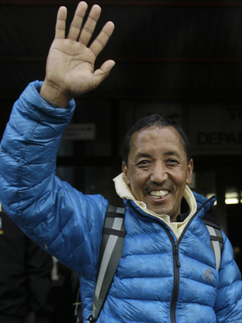 In this April 6, 2011 file photo, Nepalese veteran mountaineer Apa Sherpa waves to supporters at the airport before leaving for Mount Everest on an expedition to clear away tons of trash left on the world's highest peak, in Katmandu, Nepal. An official says Apa has broken his own record for most climbs of Mount Everest by scaling the world's tallest peak for the 21st time on Wednesday, May 11, 2011. (AP Photo/Binod Joshi, File)
