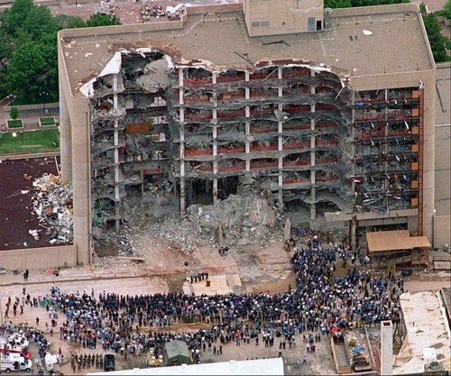 In this May 5, 1995 file photo, thousands of search and rescue crews attend a memorial service in front of the Alfred P. Murrah Federal Building in Oklahoma City.  More than 600 people were injured in the April 19, 1995 attack and 168 people were killed. Timothy McVeigh was executed in 2001 and Terry Nichols is serving multiple life sentences on federal and state convictions for their convictions in the bombing. (AP Photo/Bill Waugh, FIle)