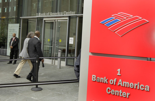 Mike Broadway, left, and Donnie Garris, right, walk into the Bank of America shareholders meeting in Charlotte, N.C., Wednesday, May 11, 2011. (AP Photo/Chuck Burton)