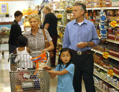 File Photo  |  The Salt Lake Tribune Then-Gov. Jon Huntsman, first lady Mary Kaye and children Gracie Mei, right, and Asha, in cart, shop for food at a Smith's grocery store in 2007 as part of a food-stamp challenge. The couple were close friends with a same-sex couple -- a relationship that influenced Huntsman's pro-civil unions stance.