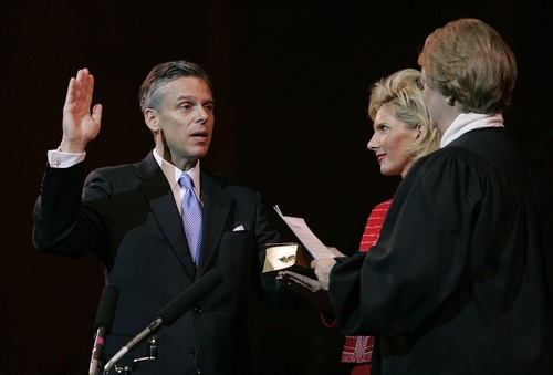File Photo  |  The Associated Press Jon Huntsman Jr. is sworn in as Utah governor by Supreme Court Chief Justice Christine M. Durham during a inaugural ceremony Monday, Jan. 3, 2005. Mary Kaye Huntsman, holds the Bible.