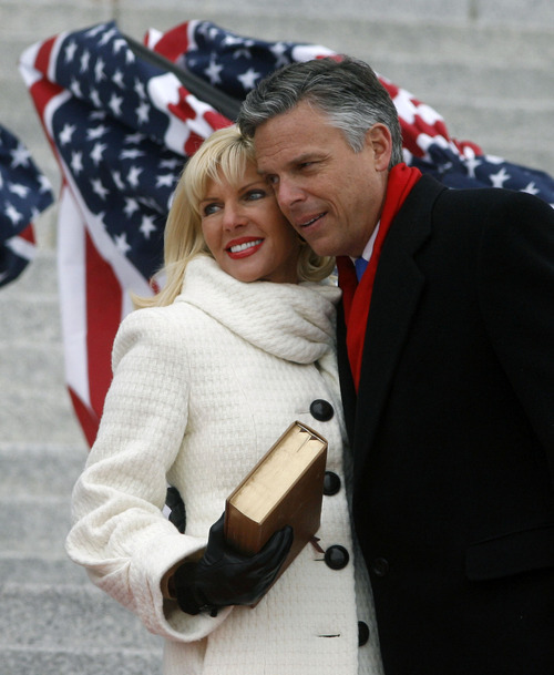 File Photo   |  The Salt Lake Tribune Then-Utah Gov. Jon Huntsman Jr. hugs his wife Mary Kaye Huntsman after taking the oath of office for the second time on the steps of the state Capitol in this 2009 Tribune file photo.