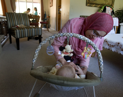 Steve Griffin     The Salt Lake Tribune   Arshia Kergaye puts her newborn baby Noah down for a nap during dinner with her son Zain, daughter Leena and husband Cameron during dinner at their Millcreek home on Wednesday, May 4, 2011. Kergaye's fourth child Adam is not in the picture.