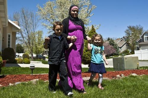 Chris Detrick   The Salt Lake Tribune  Sharifa Al-Qaaydeh and her kids Sajed, 5, and Summer, 3, walk around their home Wednesday May 4, 2011.