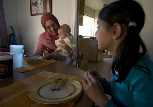 Steve Griffin     The Salt Lake Tribune   Arshia Kergaye holds her newborn baby Noah during dinner  at her Millcreek home on Wednesday, May 4, 2011. Her oldest child Leena is at right.