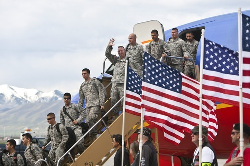 CHRIS DETRICK | The Salt Lake Tribune  Members of the 19th Special Forces Group arrive at the Utah Air National Guard Base Saturday.  About 100 Soldiers of the Utah National Guard's Group Support Company, 19th Special Forces Group (Airborne), returned to Utah from their 12-month deployment to Iraq.