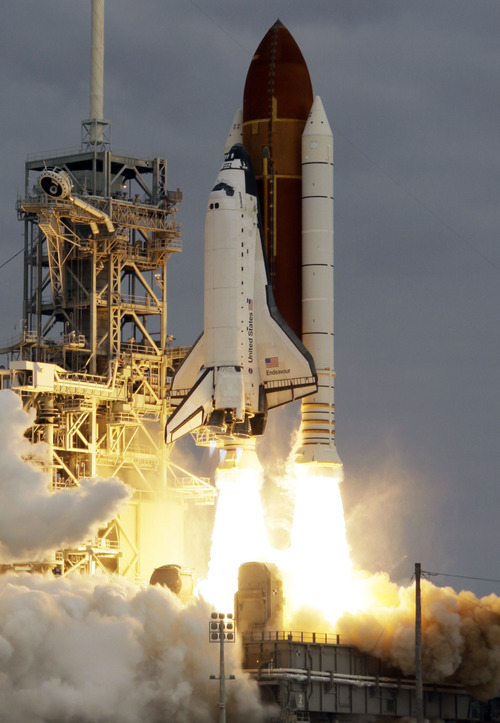 The space shuttle Endeavour lifts off from Cape Canaveral, Fla., Monday. Endeavour began a 14-day mission to the international space station.  John Raoux  |  The Associated Press