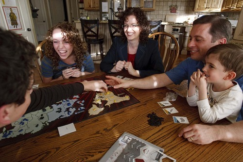 Trent Nelson  |  The Salt Lake Tribune New state Sen. Aaron Osmond, right, plays a game of Risk on Friday with son Jameson, left, daughter Madalyn, wife Nancy and son Jackson.