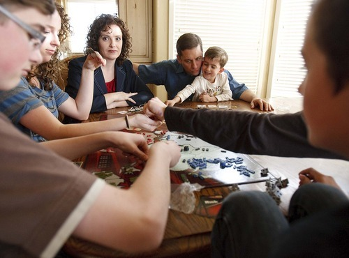Trent Nelson  |  The Salt Lake Tribune New state Sen. Aaron Osmond, right, plays a game of Risk on Friday with his family in South Jordan. From left are Daniel, Madalyn, wife Nancy, Jackson and Jameson.