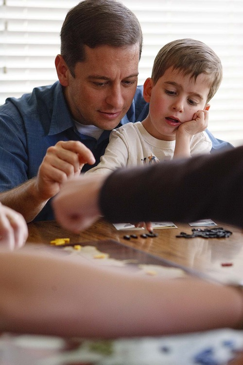 Trent Nelson  |  The Salt Lake Tribune New state Sen. Aaron Osmond, left, and his son Jackson play a game of Risk on Friday with the family in South Jordan.