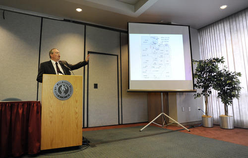 SARAH A. MILLER  |  The Salt Lake Tribune Joe Dunlop presents four congressional district maps created by a citizens group who say they represent a