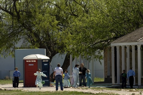 San Angelo, Texas --4/10/08-- FLDS women and children play outside at Fort Concho in San Angelo, Texas, where they are being housed temporarily.  ************ Texas authorities said today that they have completed their investigation of the polygamous FLDS sect's YFZ Ranch at Eldorado and have left the property.   Photo by Chris Detrick/The Salt Lake Tribune