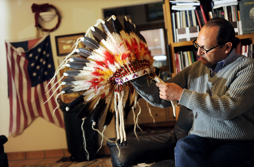 Sarah A. Miller  |  The Salt Lake Tribune  Collector Christopher Kortlander holds one of his artifacts, an American Indian headdress, at his home and museum March 23, in Garryowen, Montana. Kortlander is suing the federal government, saying it violated his rights during a raid of artifacts that occurred on his property in 2005.