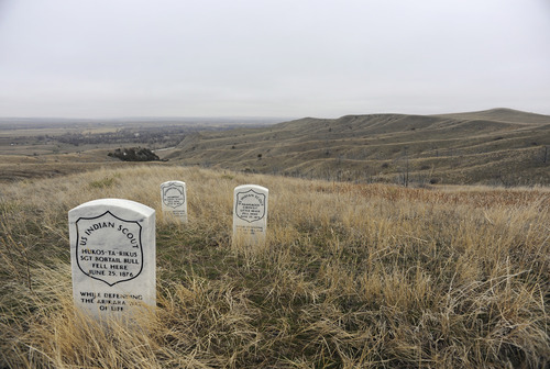 Sarah A. Miller  |  The Salt Lake Tribune  Headstones mark where three U.S. soldiers fell during the Battle of Little Bighorn. Taking artifacts from American Indian lands and the national monument is illegal.