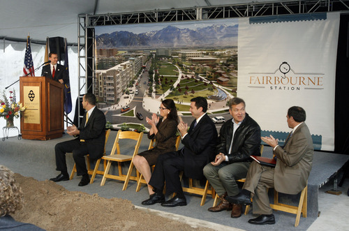 Francisco Kjolseth  |  The Salt Lake Tribune West Valley City mayor Mike Winder, left, unrolls a large rendering of the city's new downtown development project called Fairbourne Station during a groundbreaking ceremony on Thursday, May 19, 2011. Also pictured sitting from left are City Manager Wayne Pyle; Nicole Cottle, community and economic development director; U.S. Rep. Jason Chaffetz; U.S. Rep. Jim Matheson; and Gov. Gary Herbert.