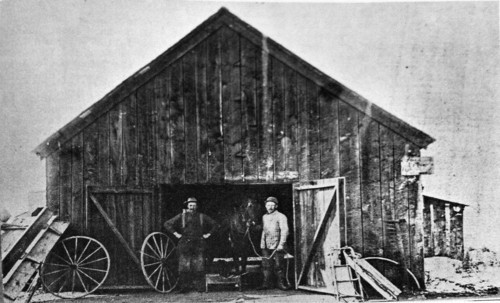 Joseph Watson Fairbourne and Frederick Neilsen at Fairbourne's blacksmith shop. Courtesy West Valley City Public Relations